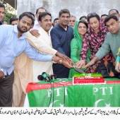 PTI holds a cake cutting ceremony at NA-127 Party Office