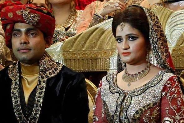 Omar Akma with his bride.jpg