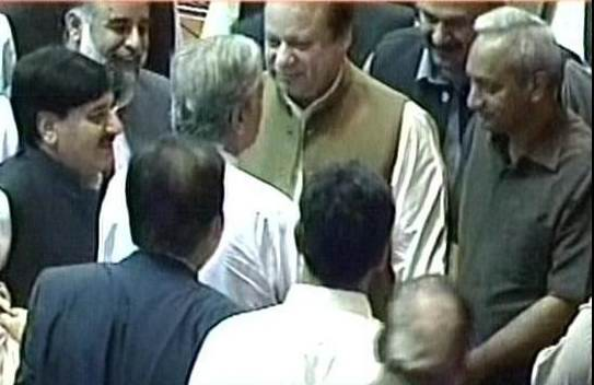 PM hugs Javaid Hashmi in parliament.jpg