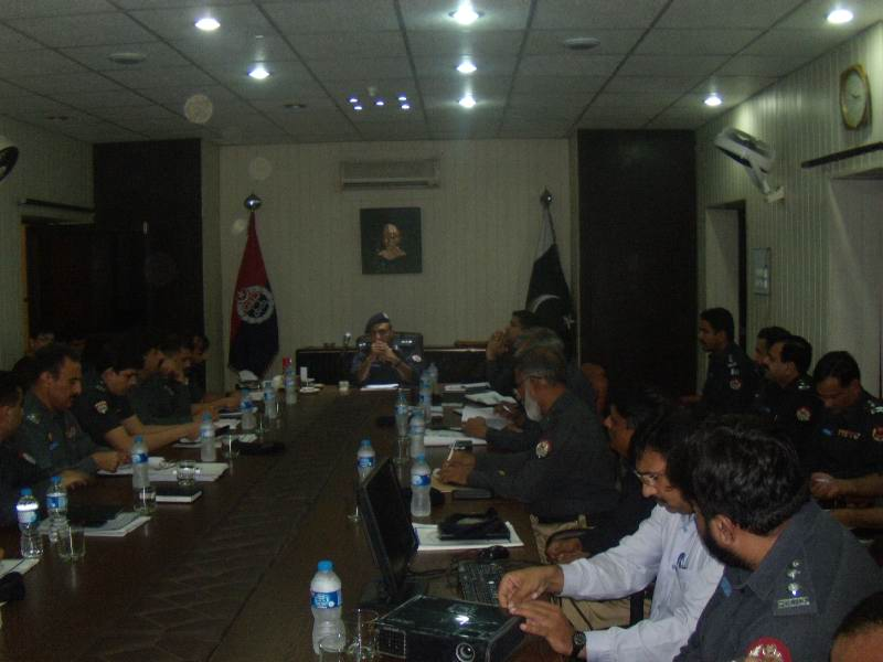 DIG ops Dr Haider Ashraf is presing over a crime meeting.JPG